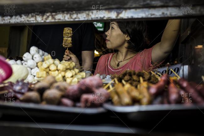 Yangon, Myanmar - 19 September 2016: Street food stand at Yangon's chinatown