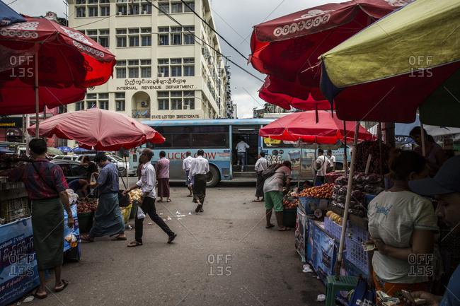 Yangon, Myanmar - 19 September 2016: Street market selling fruit in downtown Yangon