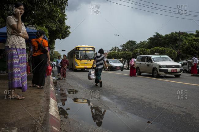 Yangon, Myanmar - 19 September 2016: Waiting for the bus in downtown Yangon