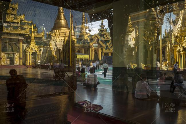 Yangon, Myanmar - 19 September 2016: Reflections inside Shwedagon Pagoda complex
