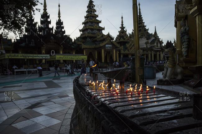 Yangon, Myanmar - 19 September 2016: Candles burning at Shwedagon Pagoda