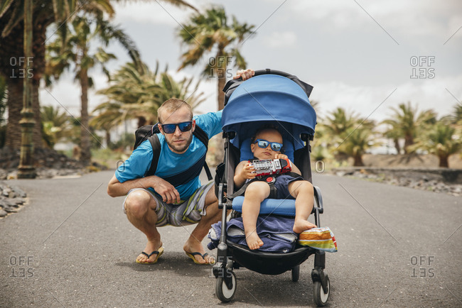 Portrait of father and his son wearing sunglasses