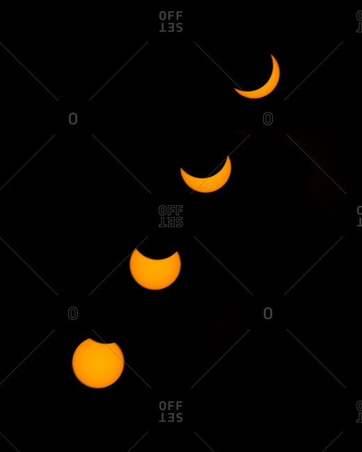 Four different phases of the solar eclipse with 80% coverage of the sun as seen from South Lake Tahoe, California