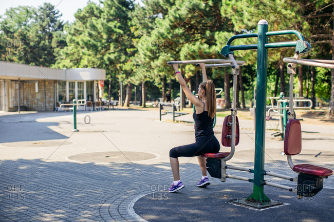 Woman working out at park fitness station