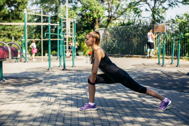 Woman doing a lunge during workout at playground