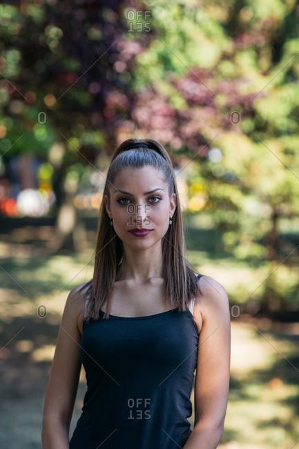 Portrait of beautiful woman in a park