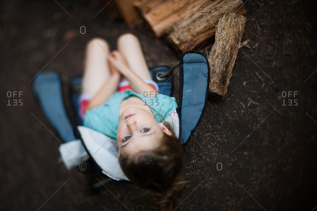 Overhead view of young girl sitting on quad chair