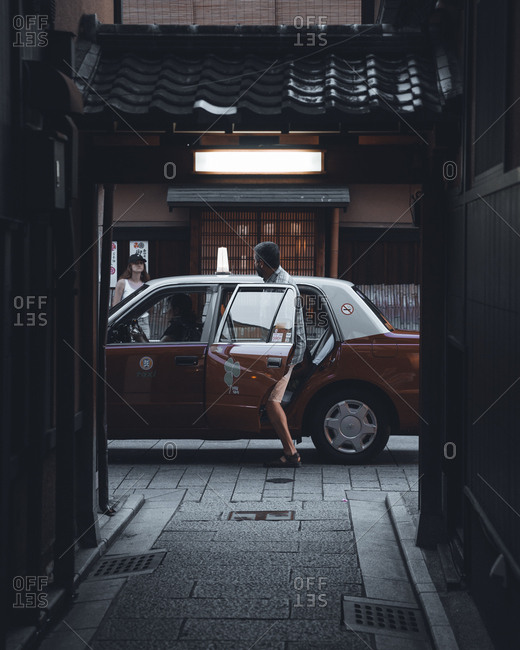 Kyoto, Japan - July 3, 2017: Man getting into taxi