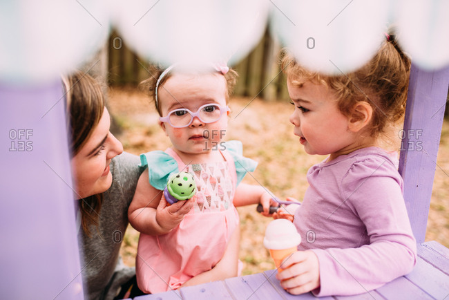 Mother with kids playing with toy ice cream cones