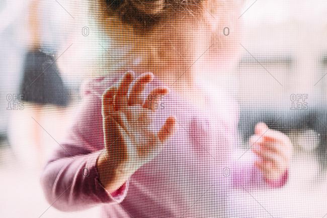 Young girl touching screen