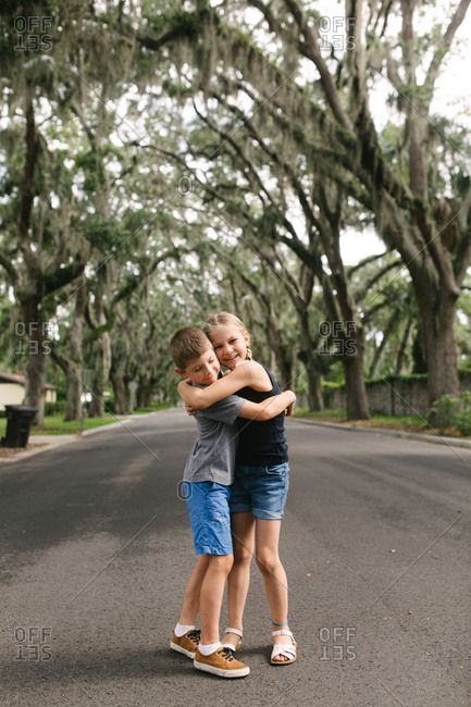 Kids hugging in a street