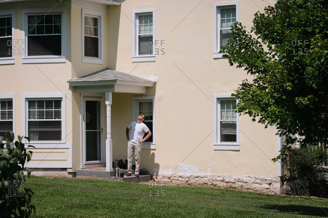 Man on back porch of house