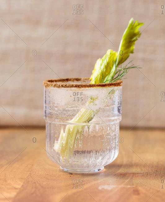 Sparkling drink served with celery stalk