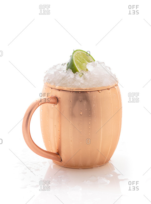 Mug filled with crushed ice and lime wedge