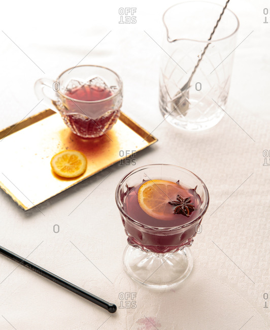 Spiced mixed drink garnished with orange slice and star anise