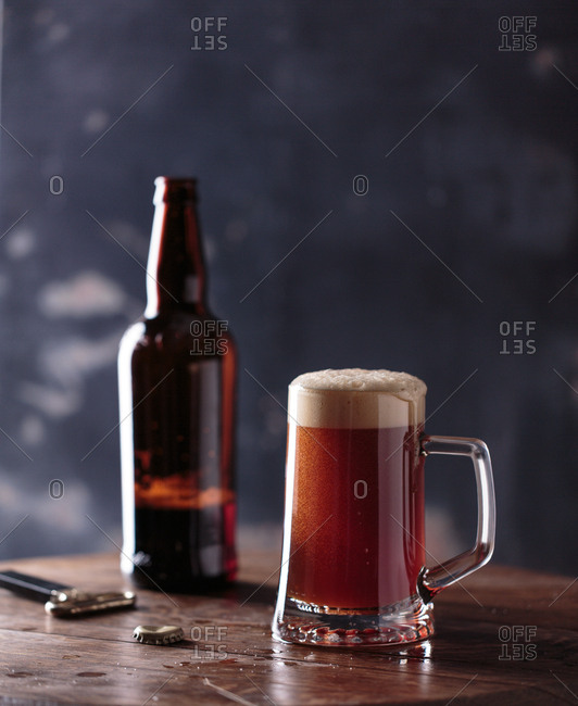 Glass of beer with bottle