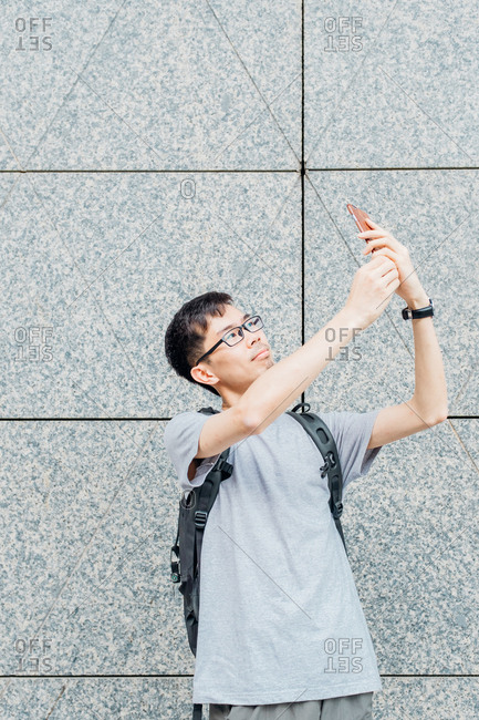 Asian man selfie using a cell phone