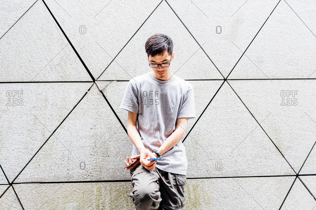 Asian man playing with a fidget spinner