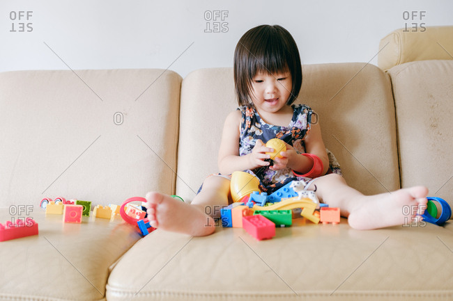 Asian little girl playing with building blocks