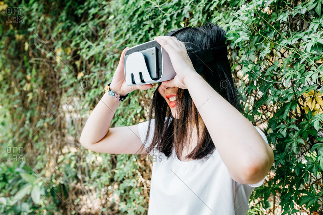 Asian woman with virtual reality headset outdoor