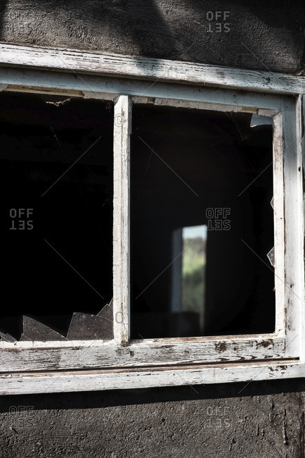 Window frame with broken glass