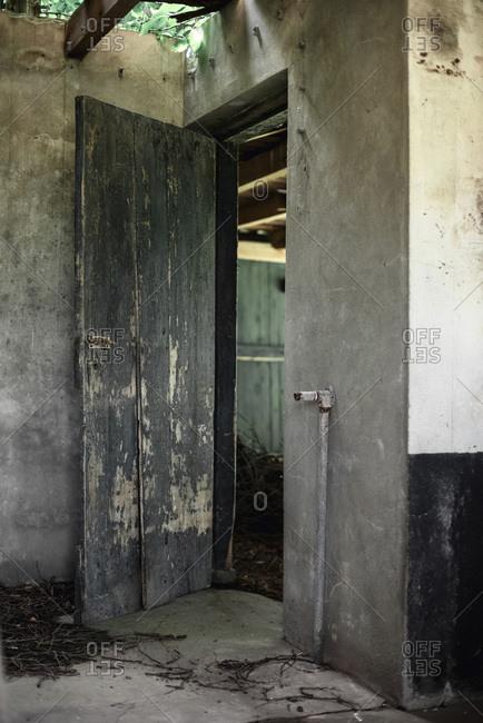Open door in old abandoned barn
