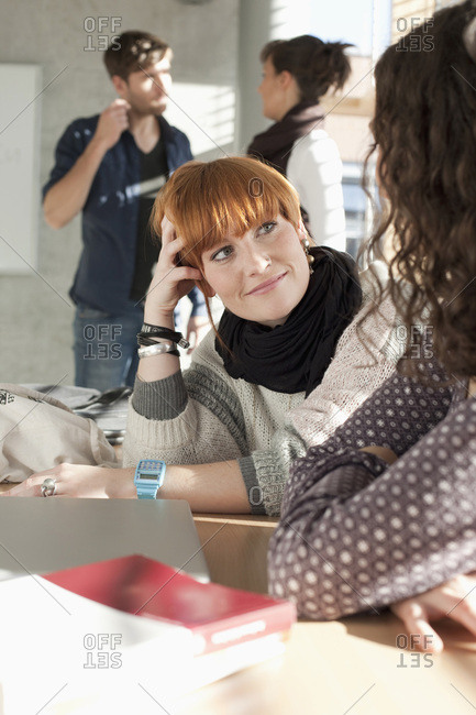 Germany- Leipzig- Women talking with students standing in background