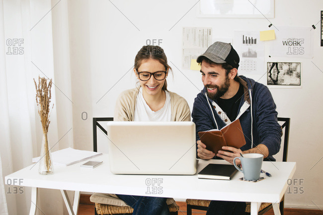 Young couple working at modern home office