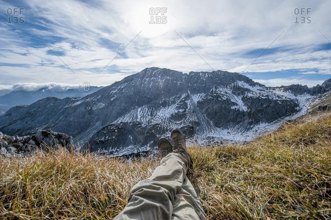 Austria- Salzburg State- Altenmarkt-Zauchensee- man's legs in front of snow-capped cirque