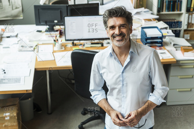 Successful architect standing in his office