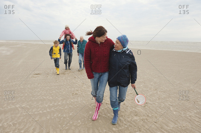 Germany- St. Peter-Ording- North Sea- Family  walking on beach