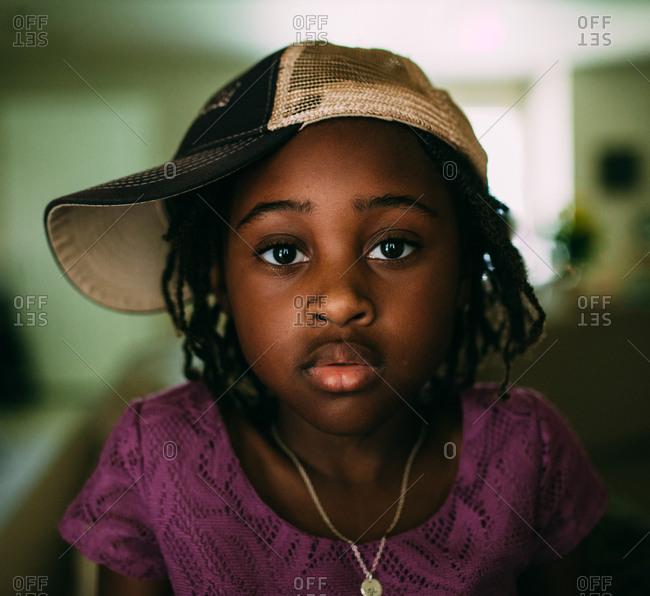 Girl wearing a sideways ball cap