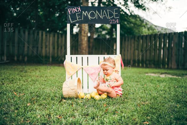Girl cries over spilled lemons at lemonade stand