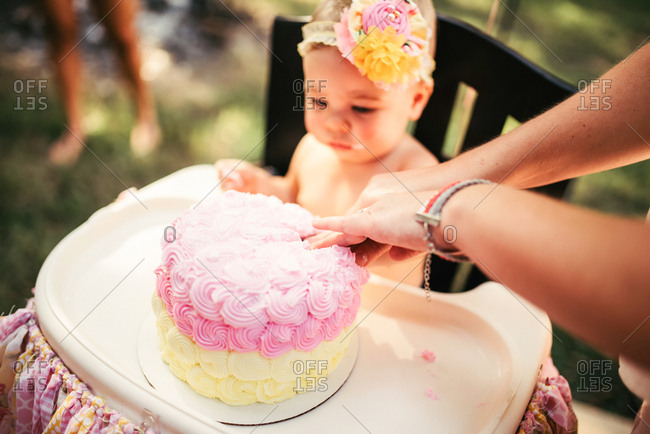 A birthday baby waits for cake