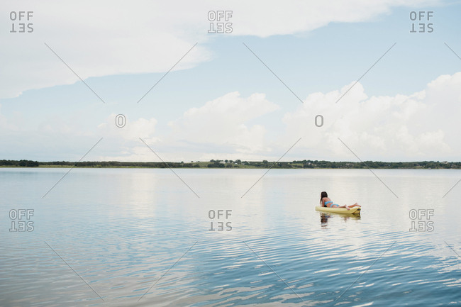 Teen girl on kayak in lake in Florida