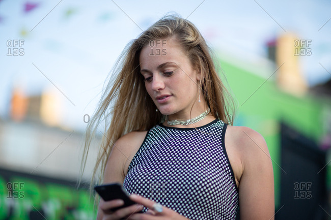 Young female on smartphone at an outdoor market