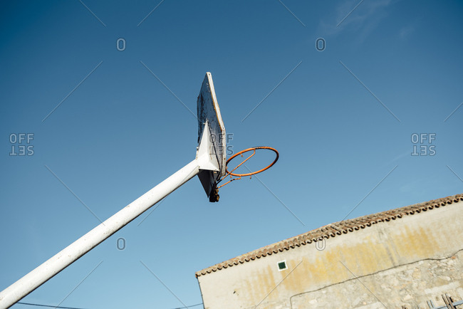 Basketball basket crossing the sky near a town house in Avila, Spain