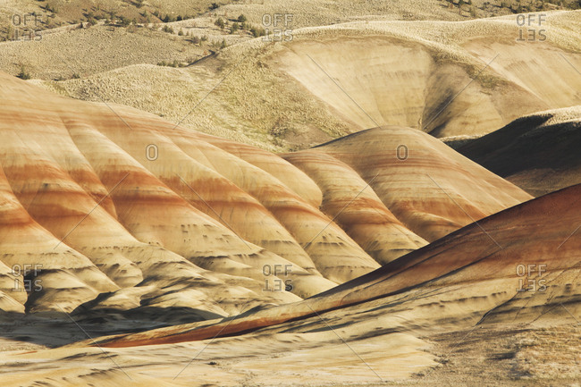 The Painted Hills, landscape with red layers running through the slopes in the John Day Fossil Beds National Monument in Oregon