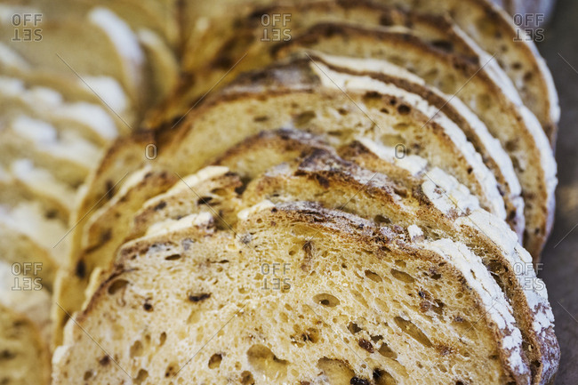 Close up of a freshly baked loaf of bread cut into slices