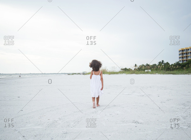 A girl walks on the beach