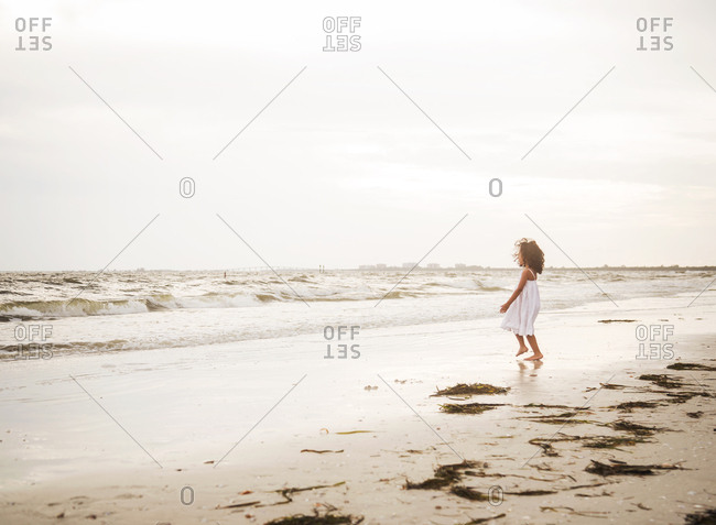A girl plays at the beach