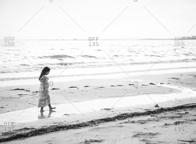 A girl walks along the beach