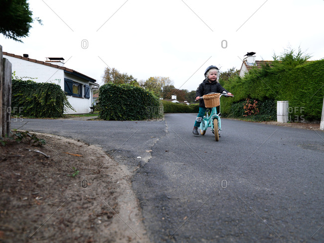 A young girl having fun with her blue mint bicycle