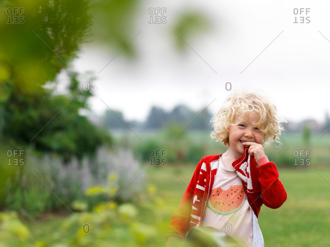 A young girl smiling and having fun in the garden