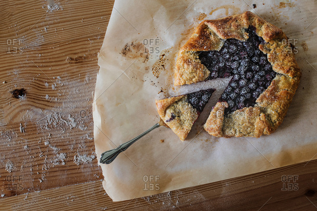 Blueberry galette on parchment paper dusted with flour