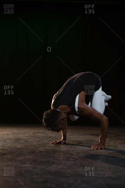 Ballerino practicing ballet dance in the stage