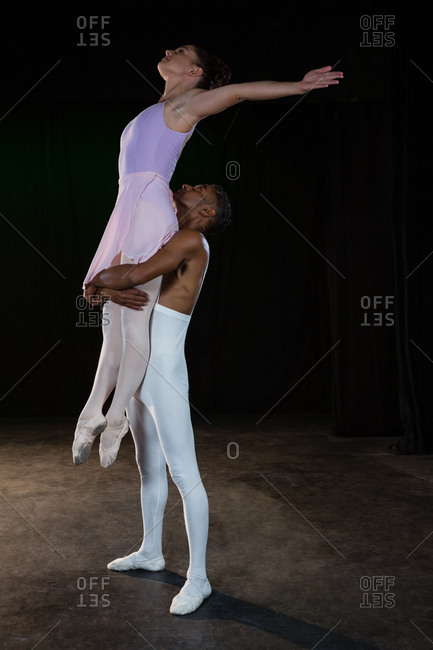 Ballet partners practicing ballet dance in stage