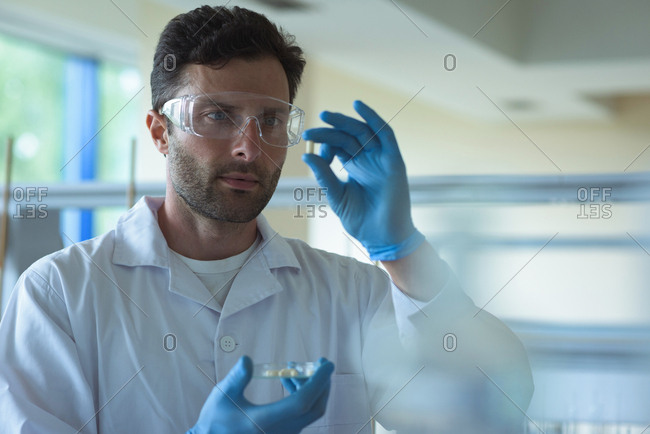 Attentive university student doing a experiment in laboratory