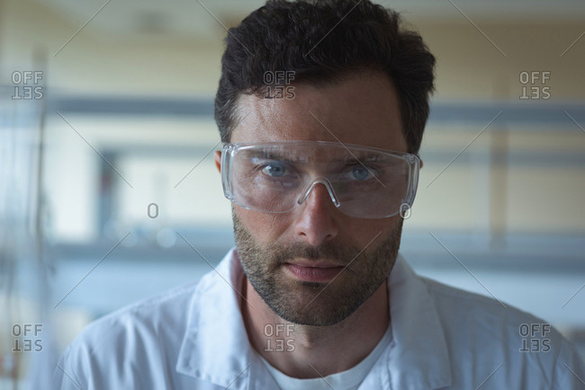 Portrait of university student in protective eyewear at laboratory