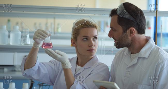 University student investigating a scientific experiement